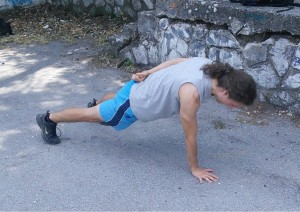 One arm push up starting position